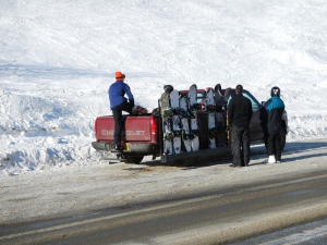Hard Core Snowboarders Ride in the back of a pickup as far as they can before hiking to the top of the ridge.  Hatcher Pass