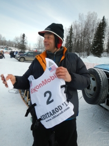 Martin Buser getting his official bib at the Re-Start in Willow, AK.