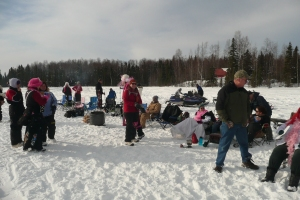 Iditarod means party time on the lake - bon fires, roasting hot dogs, snowmobiles, helicopters, planes, and lots of good times!